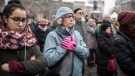 Residents react during a gathering in a central square of the eastern French city of Strasbourg, Sunday Dec.16, 2018 to pay homage to the victims of a gunman who killed four people and wounded a dozen more. (AP Photo/Jean-Francois Badias)