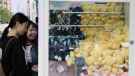 Women playing a claw crane machine in Taipei. Sam YEH / AFP