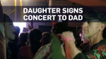 Caught on cam: Girl signs concert to deaf dad