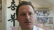 In this image made from video taken on March 2, 2017, Michael Spavor, director of Paektu Cultural Exchange, talks during a Skype interview in Yangi, China.  THE CANADIAN PRESS/AP