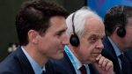 In this Nov. 14, 2018 photo, Canada's Ambassador to China John McCallum sits next to Prime Minister Justin Trudeau, left, during a bilateral meeting with Chinese Premier Li Keqiang in Singapore. THE CANADIAN PRESS/Adrian Wyld