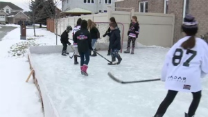 Cory Cosgrove, who built the rink for his three daughters, said he was initially told by a city bylaw officer that the boards of the rink were on city property, so he moved them back.