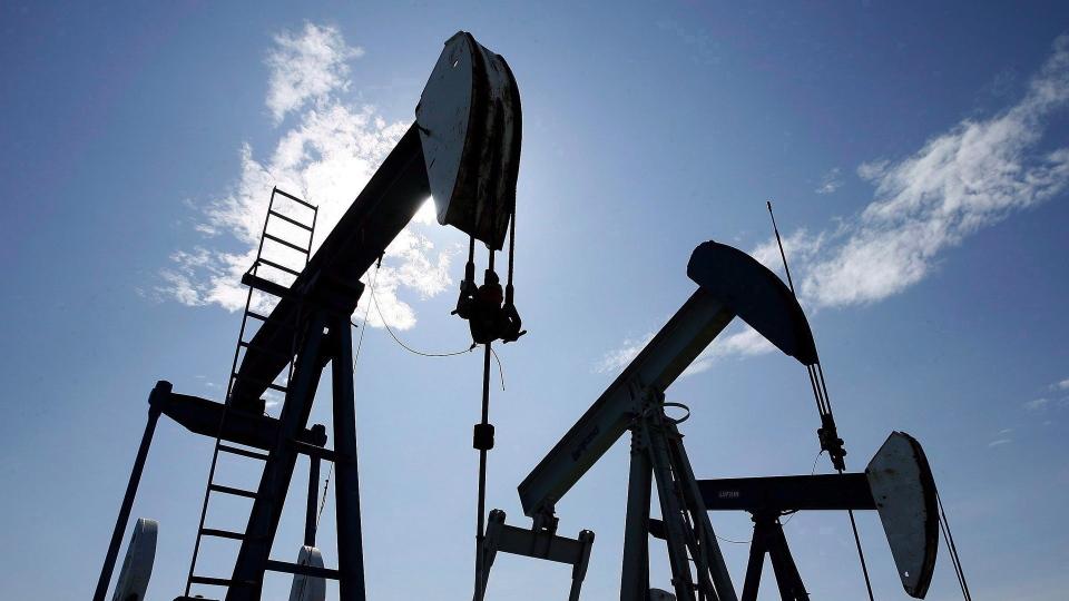 Pumpjacks pump crude oil near Halkirk, Alta. on June 20, 2007. THE CANADIAN PRESS/Larry MacDougal