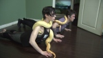 Tristan Risk (front) and Joshua Burns are bringing snake yoga to Vancouver.