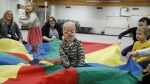 Porter Stanley takes part in the parachute game at preschool in Onoway, Alta., on Wednesday, November 7, 2018. Porter Stanley is one of 30 people in the world to be diagnosed with Beare-Stevenson syndrome, a craniofacial disorder.JASON FRANSON / THE CANADIAN PRESS