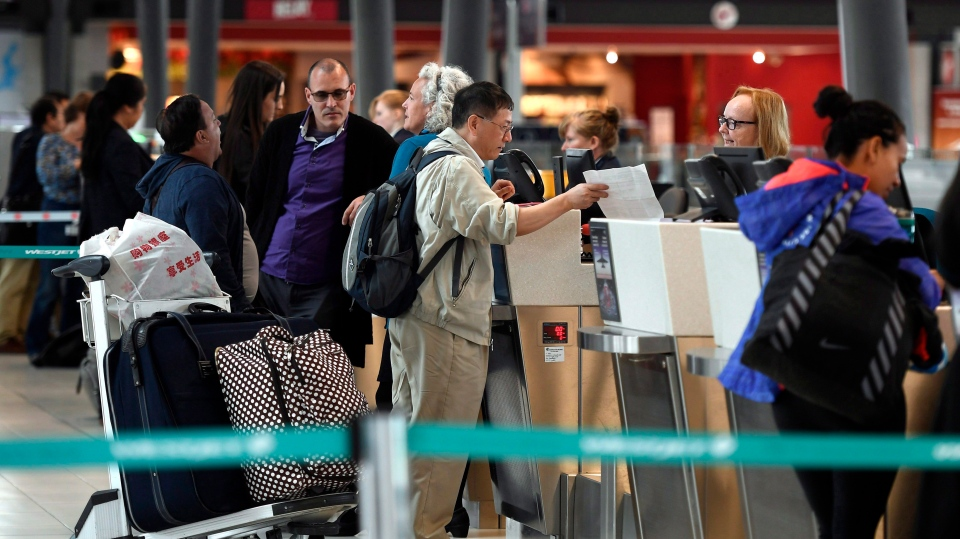 Passengers check in for flights in the departures terminal at the Ottawa International Airport on Monday, May 28, 2018. (THE CANADIAN PRESS / Justin Tang)