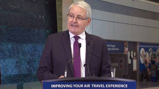 Transportation Minister Marc Garneau delivers remarks at Ottawa International Airport, Monday, Dec. 17, 2018.