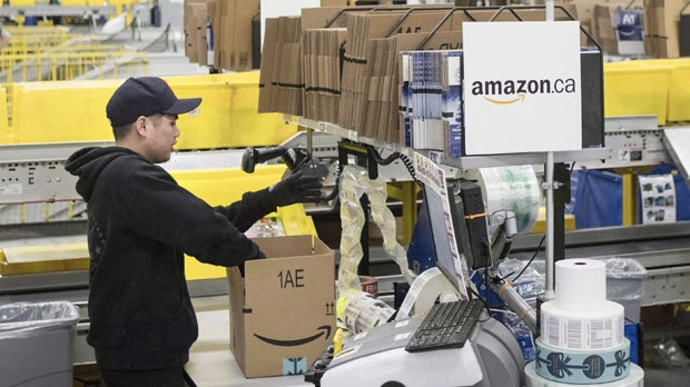 An employee works at the the Amazon fulfillment centre in Brampton, Ont. on Monday, November 26, 2018. Online retail giant Amazon is opening a new fulfillment center in Leduc County, just south of Edmonton, with plans to create 600 full-time jobs by 2020. THE CANADIAN PRESS/Chris Young