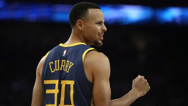 8847ef009c9c Golden State Warriors  Stephen Curry celebrates a score against the Memphis  Grizzlies during the first half of an NBA basketball game Monday