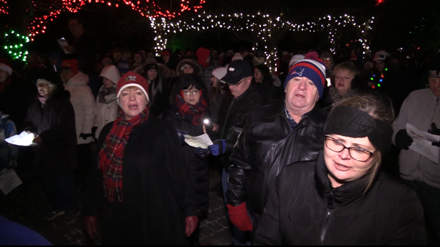 Carollers fill Exeter, Ont.'s MacNaughton Park to fulfill a local man's dying Chrismas wish on Dec. 17, 2018.  (Scott Miller/CTV London)