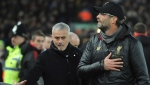 In this Sunday, Dec. 16, 2018 file photo Liverpool manager Juergen Klopp, right, and Manchester United manager Jose Mourinho seen prior to the English Premier League soccer match between Liverpool and Manchester United at Anfield in Liverpool, England. (AP Photo/Rui Vieira)