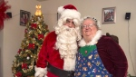 Ted Carroll, a Santa-for-hire, and his wife Kim, as Mrs. Claus, display their outfits in Halifax on Dec. 17, 2018. Professional Santas and their associates across the country are into the busy season as Christmas draws closer. (THE CANADIAN PRESS/Andrew Vaughan)