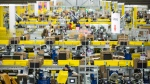 Employees work at the Amazon fulfillment centre in Brampton, Ont. on Monday, November 26, 2018. (THE CANADIAN PRESS / Chris Young)