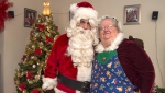 Ted Carroll, a Santa-for-hire, and his wife Kim, as Mrs. Claus, display their outfits in Halifax on Dec. 17, 2018. THE CANADIAN PRESS/Andrew Vaughan