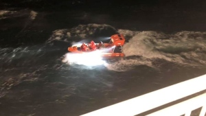 A rescue boat launched from a BC Ferries vessel near Sidney to rescue a man from a sinking boat. Dec .17, 2018. (Facebook)