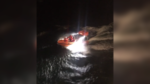 A B.C. ferry crew rescues a man during Monday night's powerful windstorm. Dec. 17, 2018. (Facebook/Danisha Drury)