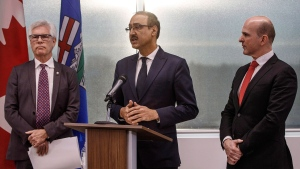 Canada's Minister of International Trade Diversification Jim Carr, left, Canada's Minister of Natural Resources Amarjeet Sohi, centre and Randy Boissonnault, Edmonton M.P. speak during press conference to announce support for Canada's oil and gas sector, in Edmonton on Tuesday, Dec. 18, 2018. THE CANADIAN PRESS/Jason Franson