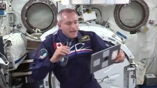 Canadian astronaut David Saint-Jacques reads from the International Space Station, Tuesday, Dec. 18, 2018.