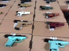 Seized firearms are seen on display in Toronto