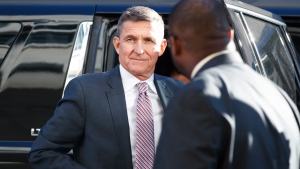 U.S. President Donald Trump's former National Security Advisor Michael Flynn arrives at federal court in Washington, Tuesday, Dec. 18, 2018. (AP Photo/Carolyn Kaster)