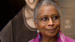 In this April 23, 2009 file photo, Alice Walker stands in front of a picture of herself from 1974 as she tours her archives at Emory University, in Atlanta. (AP Photo/John Amis, File)