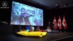 Astronaut David Saint-Jacques, aboard the ISS, reads a story to children back on Earth.