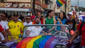 Mariela Castro, daughter of Raul Castro and director of Cuba's National Center for Sexual Education, waves a flag from a convertible car during the annual Gay Pride parade in Havana, Cuba, Saturday, May 12, 2018. (AP Photo/Desmond Boylan)