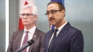Canada's Minister of Natural Resources Amarjeet Sohi, left, and Canada's Minister of International Trade Diversification Jim Carr speak during a press conference to announce support for Canada's oil and gas sector, in Edmonton on Tuesday, Dec. 18, 2018. THE CANADIAN PRESS/Jason Franson
