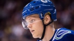 Vancouver Canucks' Olli Juolevi, of Finland, waits for a faceoff during the third period of a pre-season NHL hockey game against the Calgary Flames in Vancouver, B.C., on Wednesday September 19, 2018. Juolevi has had his season cut short by a knee injury. THE CANADIAN PRESS/Darryl Dyck