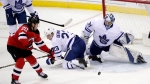 New Jersey Devils center Blake Coleman (20) attacks as Toronto Maple Leafs goaltender Frederik Andersen (31), of Denmark, defends his net during the third period of an NHL hockey game, Tuesday, Dec. 18, 2018, in Newark, N.J. The Maple Leafs won 7-2. (AP Photo/Julio Cortez)