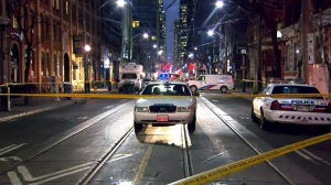Toronto police at the scene of a deadly double shooting in the city's Entertainment District on Dec. 19, 2018.