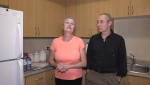 Jerry Power and Sandra Graham stand in the kitchen of their new apartment in Cambridge, Ont.