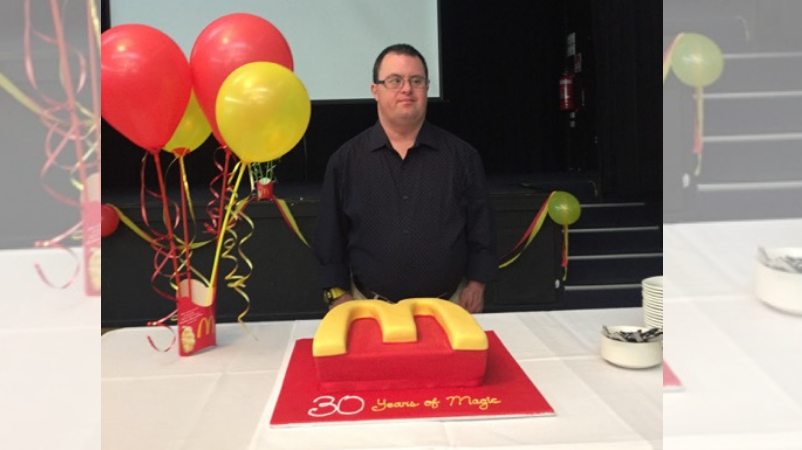 Russell O'Grady, a retiring McDonald's employee with Down syndrome in Australia back when he was celebrating 30 years on the job. (Wynn Visser/JobSupport)