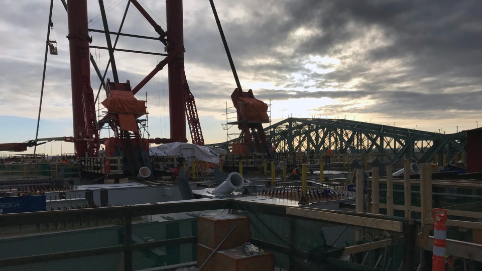 The old Champlain Bridge sits in the background as temporary structures cover the unfinished deck of the new Samuel de Champlain Bridge on Dec. 19, 2018 (CTV Montreal/Matt Grillo)