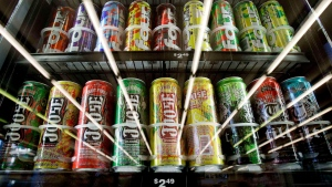 Alcoholic energy drinks are seen in a cooler reflecting overhead lights at a convenience store in Seattle, Wednesday, Nov. 10, 2010. (THE CANADIAN PRESS/AP-Elaine Thompson)