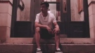 London musician Pierce Johncox or 'LIVONSATURDAY' is seen in this image from his video for the song 'Drama.'