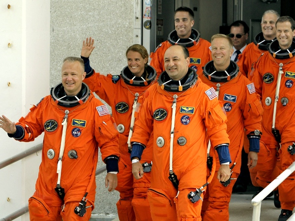 Space shuttle Endeavour astronauts, leave the Operations and Checkout Building at the Kennedy Space Center in Cape Canaveral, Fla., on Wednesday afternoon, July 15, 2009. (AP / Chris O'Meara)