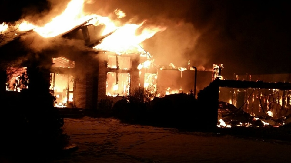 When officers arrived on scene the house was engulfed in flames. (Source: RCMP)