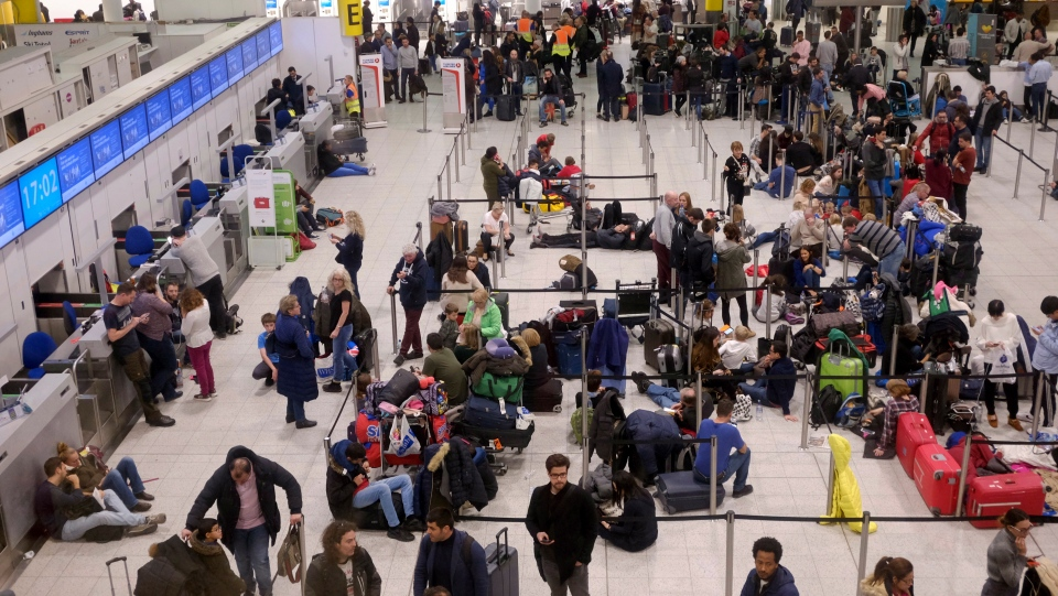 People wait in the departures area at Gatwick airport, as the airport remains closed after drones were spotted over the airfield last night and this morning, in Gatwick, England, Thursday, Dec. 20, 2018. (AP Photo/Tim Ireland)