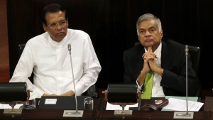 In this Oct. 3, 2017 file photo, Sri Lankan President Maithripala Sirisena, left, and Prime Minister Ranil Wickremesinghe attend a special session held to mark the country's seventieth anniversary of the first parliament of democracy, in Colombo, Sri Lanka. (Eranga Jayawardena / AP)