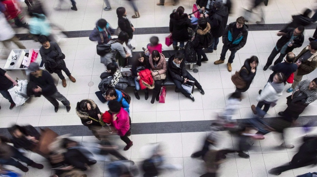 Shoppers make their way through the Eaton Centre in Toronto on December 26, 2013. THE CANADIAN PRESS/Chris Young