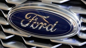 A Ford logo on display at the Pittsburgh Auto Show, on  Feb. 15, 2018. (Gene J. Puskar / AP)