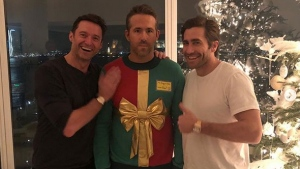Ryan Reynolds stands between Hugh Jackman and Jake Gyllenhaal at a holiday party. (Ryan Reynolds / Instagram)