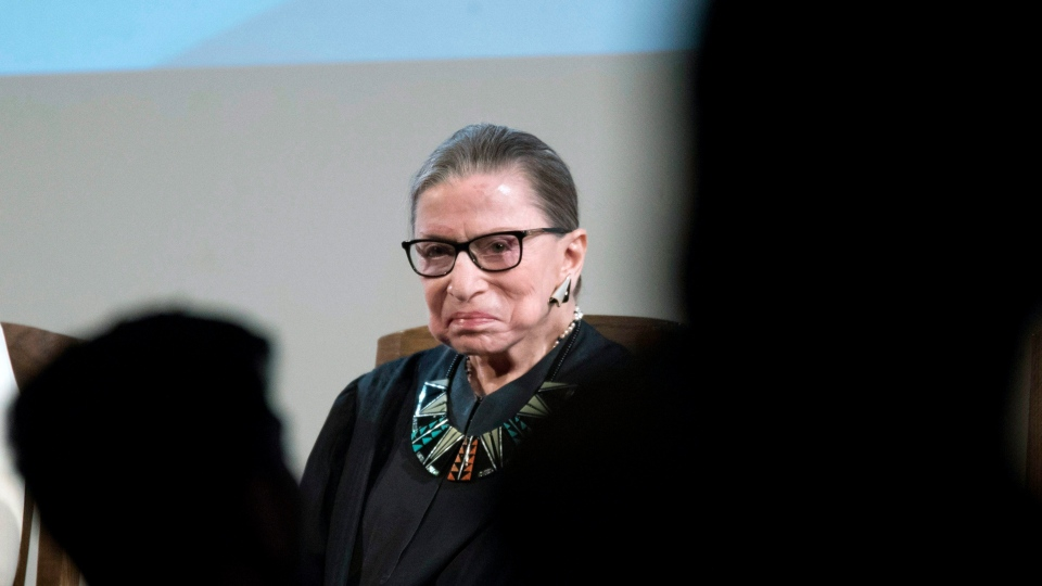 U.S. Supreme Court Justice Ruth Bader Ginsburg looks at U.S. citizenship candidates during swearing in ceremony for new American citizens, Tuesday, April 10, 2018, in New York. (AP Photo/Mary Altaffer)