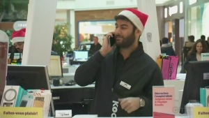 A salesman wears a Christmas hat at Fairview Pointe Claire
