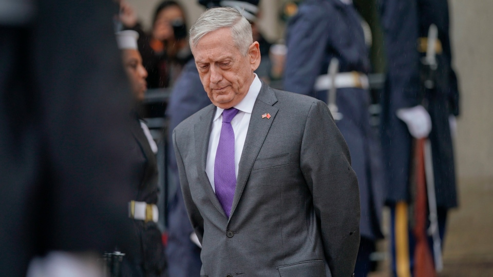 In this Nov. 9, 2018, file photo, Defense Secretary Jim Mattis waits outside the Pentagon. (AP Photo/Pablo Martinez Monsivais, File)