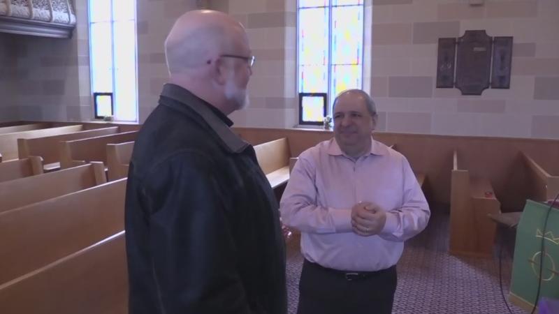 Pharmacist Michael Haddad, right, speaks with Rev. Tom Dunbar at Hensall United Church in Hensall, Ont. on Friday, Dec. 21, 2018. (Scott Miller / CTV London)