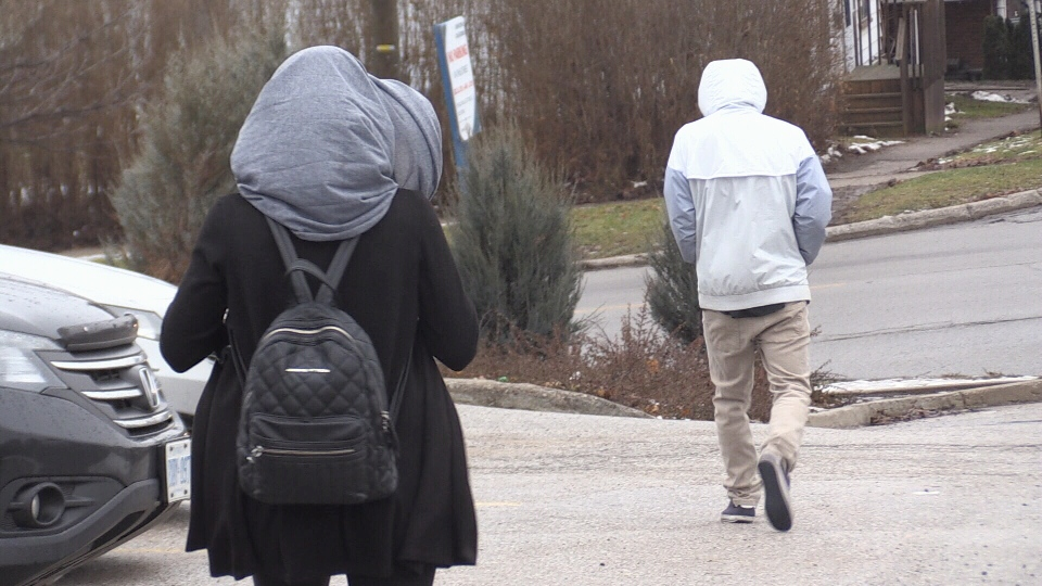 A teen and his mother leave a Barrie, Ont. courthouse on Friday, Dec. 21, 2018 (CTV News/Beatrice Vaisman)