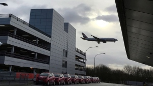 A plane comes in to land at Gatwick Airport in England, Friday, Dec. 21, 2018. Flights resumed at London's Gatwick Airport on Friday morning after drones sparked the shutdown of the airfield for more than 24 hours, leaving tens of thousands of passengers stranded or delayed during the busy holiday season.(AP / Kirsty Wigglesworth)