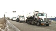 A truck convoy passes through southern Saskatchewan, on Saturday, Dec. 22, 2018.